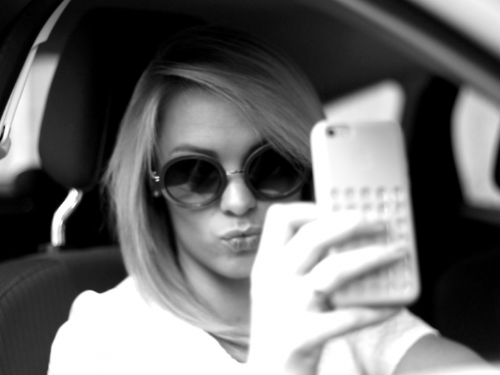 A third of young drivers admit taking 'selfies' at the wheel